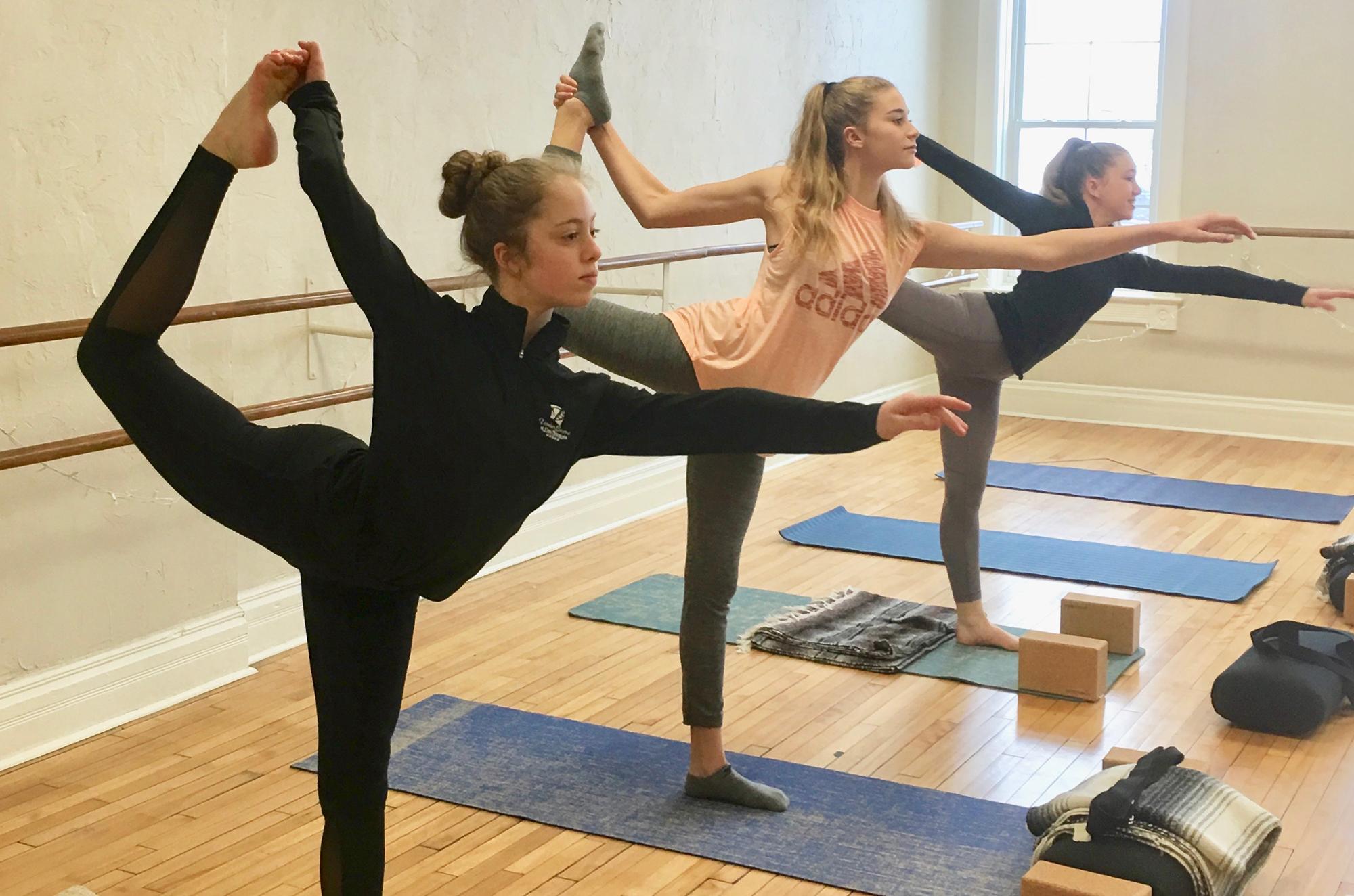Three women in a yoga class